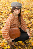 Sad young girl with handbag Royalty Free Stock Photo