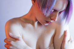 Sad young girl with pink eyes and hair, like a Stock Image