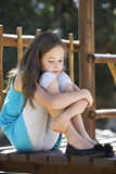 Sad Young Girl Sitting On Climbing Frame Stock Photos