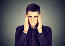 Sad young handsome man with worried stressed face expression Royalty Free Stock Photo