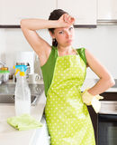 Sad young housewife cleaning furniture Stock Photos