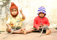 Sad Young Kids or child labour Working Royalty Free Stock Images