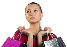 Sad young lady handing bags. Closed up Stock Photo