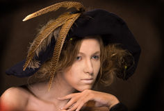 Sad young lady with a hat Royalty Free Stock Photography
