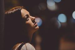 Sad young lady thinking about something leaning Stock Photo