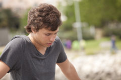 Sad young man Stock Images