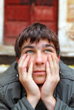 Sad young man. Portrait on the old house background Stock Photo