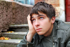 Sad young man. Portrait on the old house background royalty free stock photo