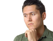 Sad young man. Sitting alone and thinking Stock Image