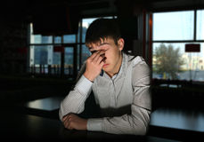 Sad Young Man at the Bar. Sad and Lonely Young Man Portrait in Dark Room Stock Images