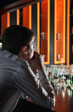Sad Young Man at the Bar Royalty Free Stock Photos