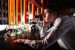 Sad Young Man at the Bar Stock Image