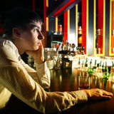 Sad Young man at the Bar Stock Photo
