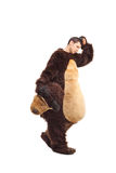 Sad young man in a bear costume walking stock photo