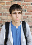 Sad Young Man. On the Brick Wall Background royalty free stock image