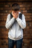 Sad Young Man. On the Brick Wall Background Stock Image