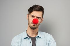 Sad young man with clown nose Royalty Free Stock Image