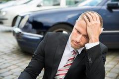 Sad young man with damaged car Royalty Free Stock Photo