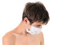 Sad Young Man in Flu Mask Royalty Free Stock Photos