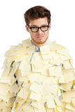Sad young man with a glasses covered with yellow sticky notes Stock Photography