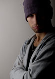 Sad young man in a hat. In the dark royalty free stock photo