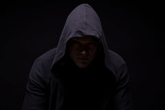 Sad young man in hood Stock Photography