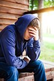 Sad Young Man outdoor. Sad Young Man near the House outdoor Stock Images