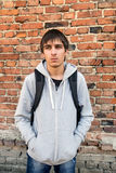 Sad Young Man outdoor. Sad Young Man on the Brick Wall Background stock image
