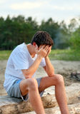 Sad Young Man outdoor. Sad Young Man on the Nature Background Royalty Free Stock Photo