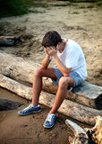 Sad Young Man outdoor. Sad Young Man on the Nature Background Stock Photography