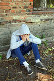 Sad Young Man outdoor. Sad Young Man near the Brick Wall of the Old House royalty free stock photos