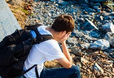 Sad Young Man outdoor. Side View of Sad Young Man outdoor Stock Photo