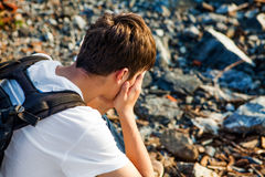 Sad Young Man outdoor. Side View of Sad Young Man outdoor Royalty Free Stock Photos