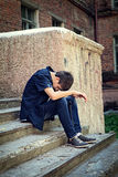 Sad Young Man outdoor. Sad Young Man sit on the City Street Stock Photography