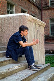 Sad Young Man outdoor. Sad Young Man sit on the City Street Royalty Free Stock Photos