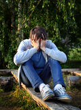 Sad Young Man outdoor. Sad Young Man sit on the Log outdoor Stock Images