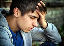 Sad Young Man outdoor. Sorrowful Young Man Portrait on the Street Stock Photography