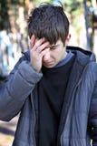 Sad Young Man outdoor. Sorrowful Young Man walking at the Park Royalty Free Stock Images