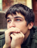 Sad Young Man outdoor. Toned Photo of Sad Young Man Portrait outdoor Royalty Free Stock Photo