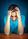 Sad Young Man. Portrait on the Blue Background Stock Photos