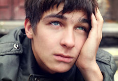 Sad Young Man. Portrait closeup on the City Street stock image