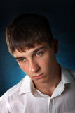 Sad Young Man Portrait. On The Dark Background stock image