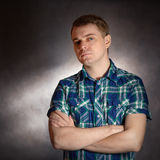 Sad young man. Sad young man, portrait on the dark background Stock Photo