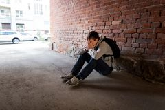 Sad Young Man. Sit on the City Street Royalty Free Stock Photos