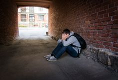 Sad Young Man. Sit on the City Street royalty free stock photography