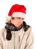 Sad Young Man in Santa Hat Royalty Free Stock Photography