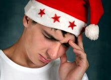 Sad Young Man in Santa Hat Royalty Free Stock Photos
