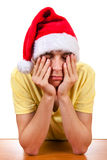 Sad Young Man in Santa Hat Stock Photos