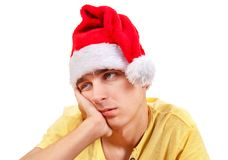 Sad Young Man in Santa Hat Stock Images