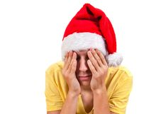 Sad Young Man in Santa Hat. Isolated On The White Background Royalty Free Stock Images